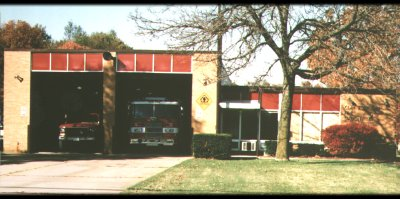Old school house housing 2 fire trucks